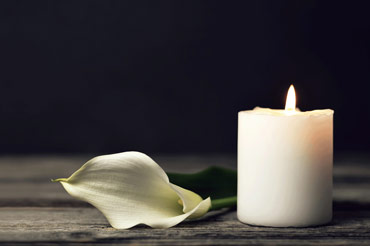 Candle with white rose petal